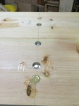 Epoxy plugs fit snuggly in the misplaced holes.
